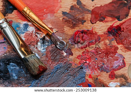 Brush and oil paint artist shot closeup - stock photo