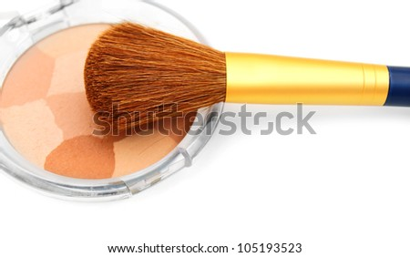 Brush and powder box. On a white background.