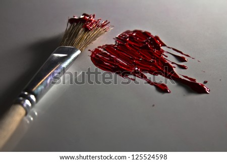 Brush and red color painted love heart