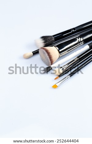 Brush away your flaws. Closeup shot of a set of professional different sizes make-up brushes spread out against a white background isolated with copy space - stock photo