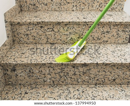 brush cleaning the stairs - stock photo