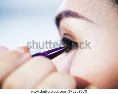 brush eye liner on pretty woman face