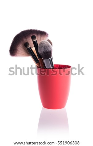 Brush for applying cosmetic make-up isolated on white