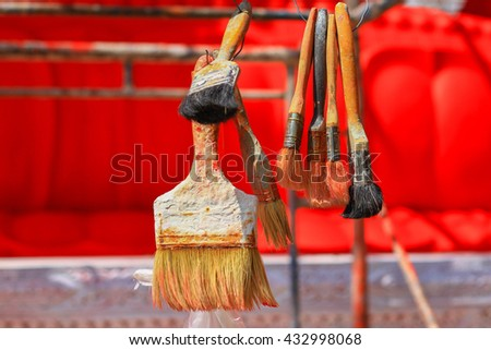Brush for painting Big Golden Buddha statue Repair:Select focus with shallow depth of field. - stock photo