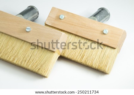 Brush for wood, the isolated image. Wooden brush with natural pile. The tool for a wood covering paint and a protective varnish.