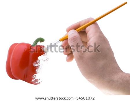 brush in the hand drawing the red paprika pepper - stock photo