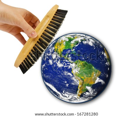 "Brush in woman hand cleaning earth ""Elements of this image furnished by NASA"""