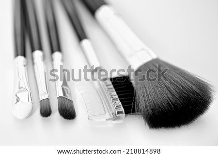 Brush makeup on gray background - stock photo