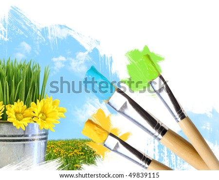 Brush painting a blue sky, green grass and flowers in pot