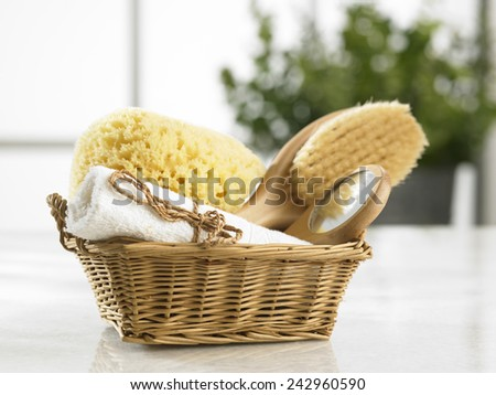 brush sponge and mirror in a basket - stock photo