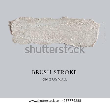 brush stroke on gray empty wall - stock photo