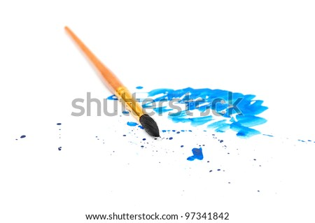 brush with blue paint stroke and stick, isolated on white