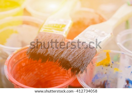 Brush with color paint, Beautiful painting collage,selective focus.vintage color - stock photo
