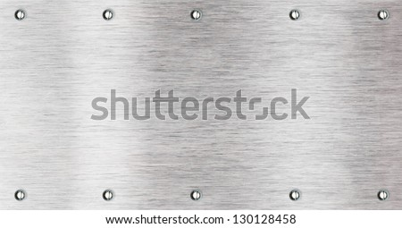 Brushed aluminum metal plate with bolts - stock photo