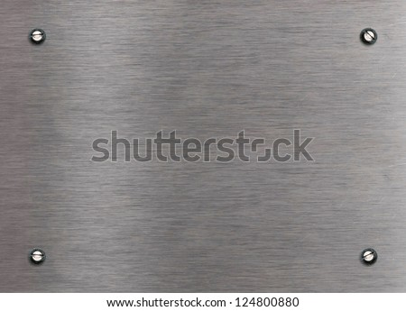 Brushed aluminum plate with bolts - stock photo