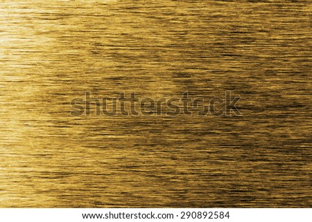 Brushed golden metal surface, view from top - stock photo