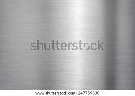 Brushed metal with bold highlight and shadow. - stock photo