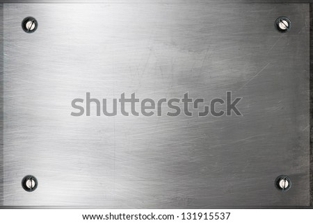 Brushed silver metal surface with bolts
