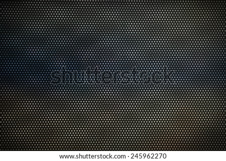 Brushed steel grill drilled with holes. dark color - stock photo