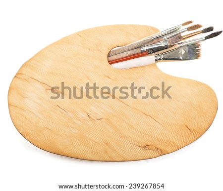Brushes and a palette of the painter isolated on a white background - stock photo