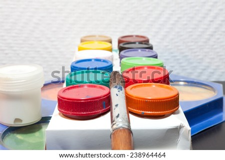 brushes and colored paint artist on white background - stock photo