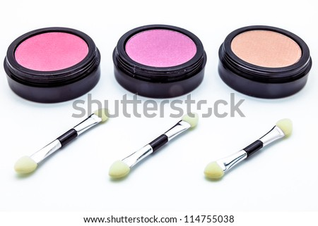 Brushes and cosmetic on a white background - stock photo