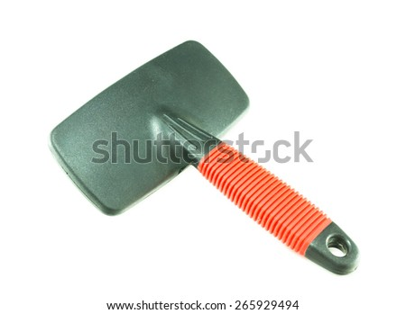 Brushes cat comb on white background - stock photo
