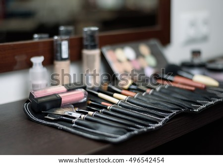 brushes for makeup in a special bag in the background cosmetics