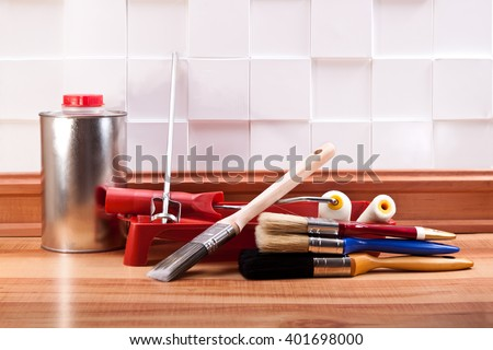 Brushes for painting, a mixer, a jar of solvent, roll on the floor in the room