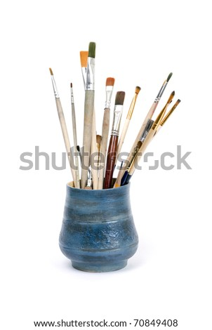 brushes in vase - stock photo