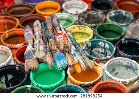 Brushes, paint cans, repair, painter - stock photo