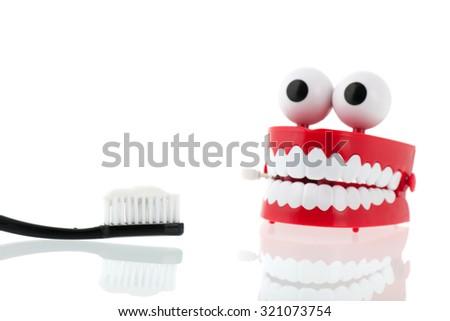Brushing dental teeth - stock photo