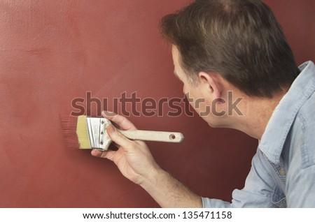 Brushing On Textured Paint - stock photo