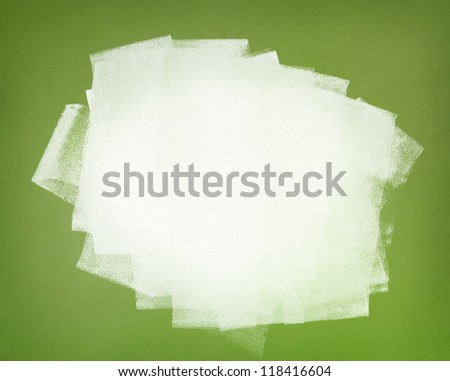 Brushstrokes of white paint covering the green wall. Abstract background. - stock photo