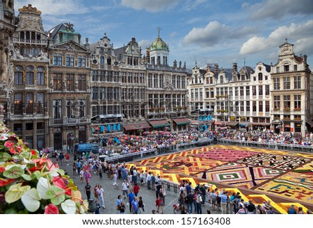 BRUSSELS - AUGUST 16: Flower Carpet Festival on August 16, 2012 in Brussels, Belgium. This biannual event takes place at the Grand Place; This year design of the carpet was in honor of Africa. - stock photo