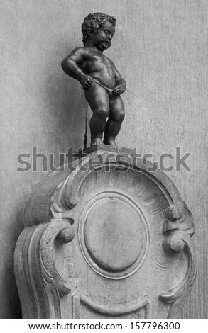 BRUSSELS - AUGUST 17: Manneken Pis statue and fountain on August 17, 2012 in Brussels, Belgium. This statue is a famous landmark and symbol of Brussels. - stock photo