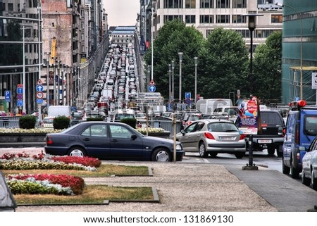 BRUSSELS - AUGUST 31: People drive in heavy traffic on August 31, 2009 in Brussels, Belgium. With 559 vehicles per 1000 people Belgium is 25th most motorized country in the world. - stock photo