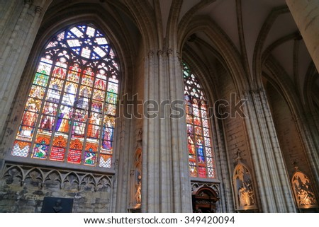 Brussels, Belgium - APR 11 2015: Beautiful stained glass cover large windows inside the Cathedral of St Michael and St Gudula  - stock photo