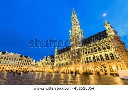 BRUSSELS, BELGIUM - APRIL 13, 2016: Grand Palace or Grote Markt is the central square of Brussels. It is surrounded by opulent guildhalls and larger edifices, the city's Town Hall and the Breadhouse. - stock photo