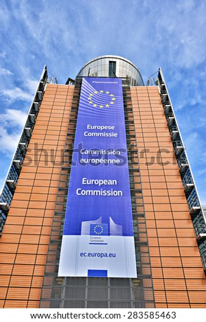 BRUSSELS, BELGIUM-APRIL 27, 2015: The European Commission headquarter the Berlaymont building decorated with EU flag and the Commission title