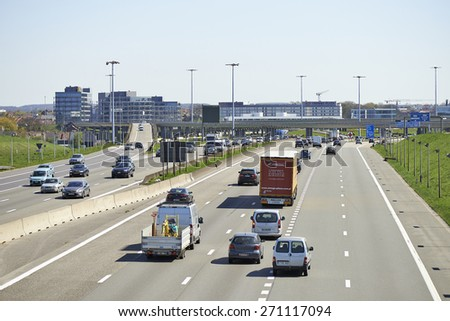 BRUSSELS, BELGIUM - APRIL 18, 2015: Traffic on the Brussels Ring by a sunny day at Diegem in Belgium - stock photo