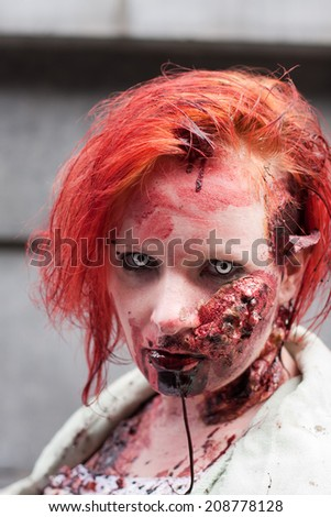 BRUSSELS, BELGIUM-APRIL 12: unknown participant at ZomBIFFF Parade (Zombie Parade) 2014 on April 12, 2014 in Brussels. The Zombie Parade was part of Brussels International Fantastic Film Festival.  - stock photo