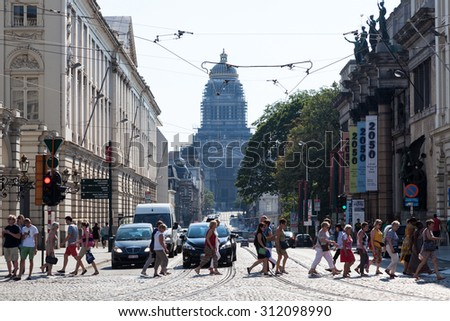 BRUSSELS, BELGIUM - AUG 22: City street and the Palace of Justice - most important court building in Belgium. August 22, 2015 in Brussels, Belgium - stock photo