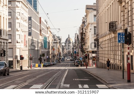BRUSSELS, BELGIUM - AUG 22: City street in Brussels with Saint Mary's Church at the end. August 22, 2015 in Brussels, Belgium