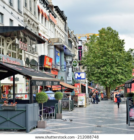 BRUSSELS, BELGIUM-AUGUST 20, 2014: Avenue de Toison d'Or. This is a famous shopping street and promenade area in Brussels - stock photo