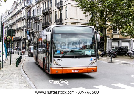 BRUSSELS, BELGIUM - AUGUST 9, 2014: City bus Van Hool A330 in the city street. - stock photo