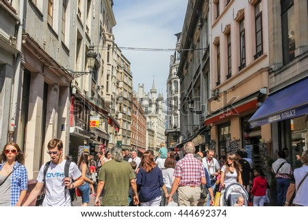 BRUSSELS, BELGIUM - AUGUST 17, 2013: crowded street with shops and boutiques, tourist shopping in Brussels. - stock photo