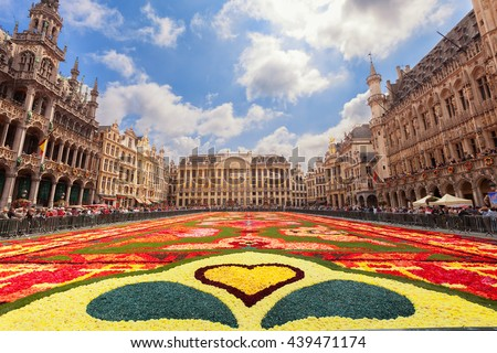 BRUSSELS, BELGIUM - AUGUST 15, 2014: Famous Grand Place during Flower Carpet Festival. Giant Turkish floral carpet within the celebrations of the 50th anniversary of Turkish workers' migration