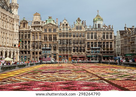 BRUSSELS, BELGIUM - AUGUST 17, 2012: Flower Carpet in front of historical buildings at the Grand Place; This year design of the carpet in this biannual event was in honor of Africa. - stock photo