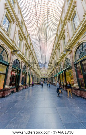 BRUSSELS, BELGIUM - 11 AUGUST, 2015: Galerie Royales Saint Hubert, very nice view down shopping alley showing spectacular glass roof construction and several shops along both sides.